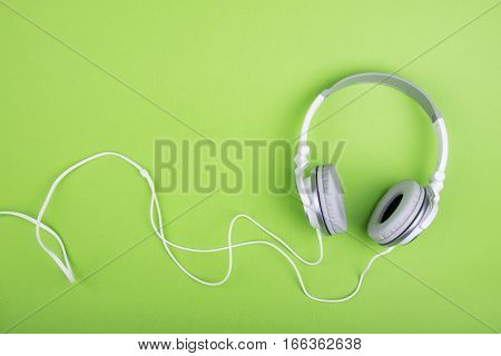 Headphones on green background. close up photo