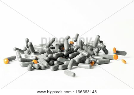 Dropping A Handful Of Medicine Pills Isolated On White Background