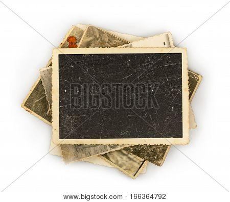 Stack of old photos isolated on white background. close up