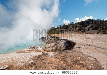 Excelsior Geyser in the Midway Geyser Basin next to the Firehole River in Yellowstone National Park in Wyoming USA