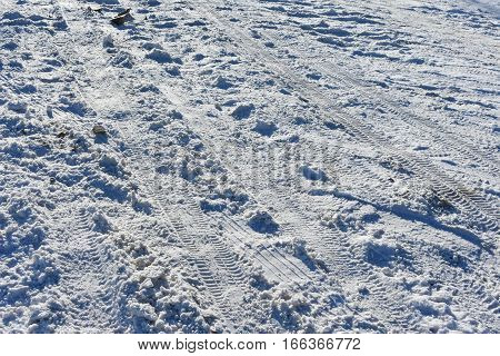 winter cold road numerous traces of the tread wheels the frozen road of snow Sunny clear day