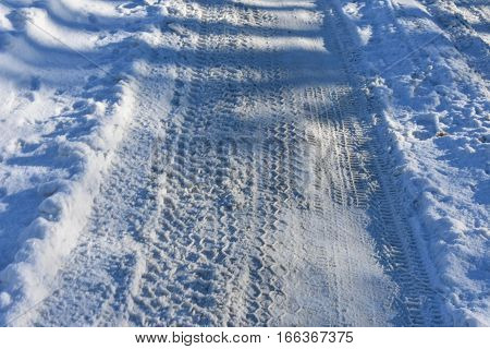 winter cold road numerous traces of the tread wheels the frozen road of snow