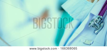 Woman doctor standing with folder at hospital .