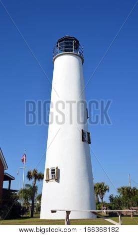 A photo of a lighthouse with blue sky