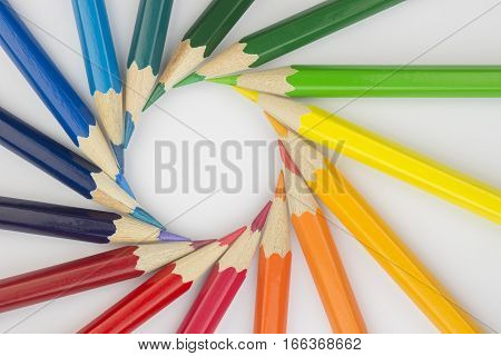 Collection of colorfull pencils in a complementary circle as a background picture