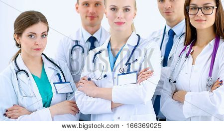 Portrait of group of smiling hospital colleagues standing together .