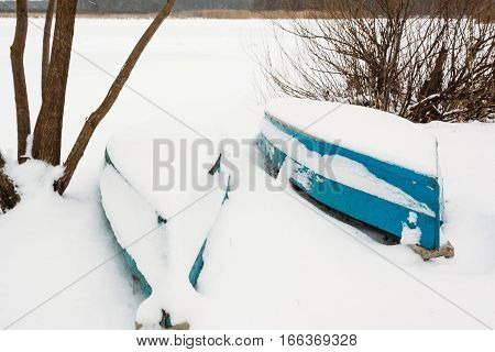 Two Boats On The Shore In Snow