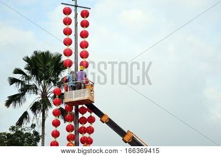 Unidentified workers prepares Chinese traditional lanterns for the upcoming Chinese New Year at a temple in Kuala Lumpur.