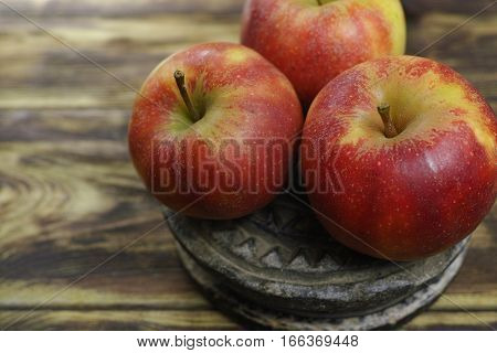 Three Fresh jonagold apples on wooden background