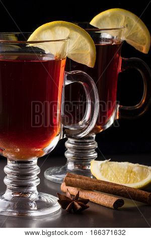 mulled wine with lemon on a dark background.