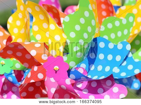 Collection of multicolored plastic pinwheel of different colors.