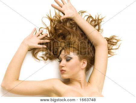 Beautiful Redheaded Topless Woman With Long Hair On White