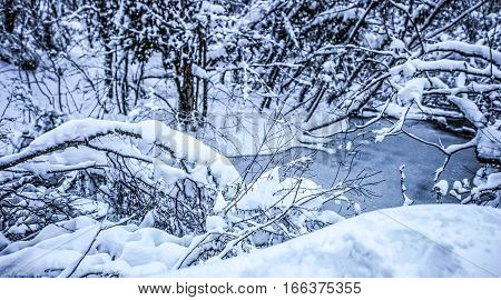 Snowy winter at Plitvice lakes in Croatia.