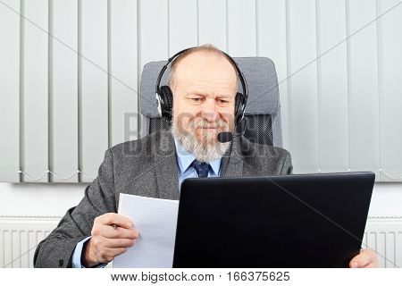 Picture of a thoughtful businessman having a video-conference at the office
