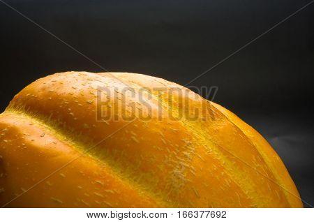 still life - ripe juicy Ethiopian melon on black background