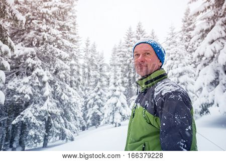 Portrait Of Happy Man In The Winter Mountains