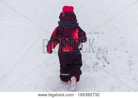 Little girl for walk in winter park