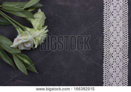 Flowers and decorative tape on dark concrete background.Greeting card. Wedding invitation concept. Valentine day.