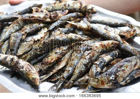Close up of a pile of Sardines grilled