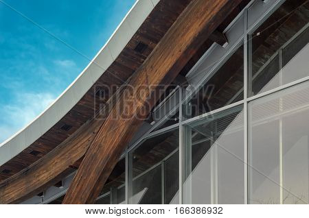 Detail of building facade. Interfacing of wooden structure glued elements. Glulam beams detail
