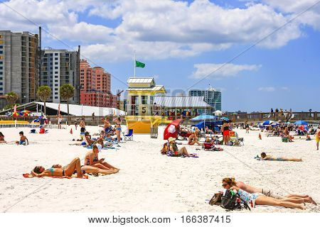 Clearwater, FL - April 21: Beach scene of people on Clearwater beach in Florida