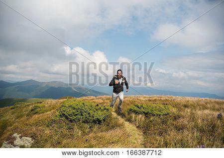 Bearded Handsome Man Jogger Run On Mountain Top
