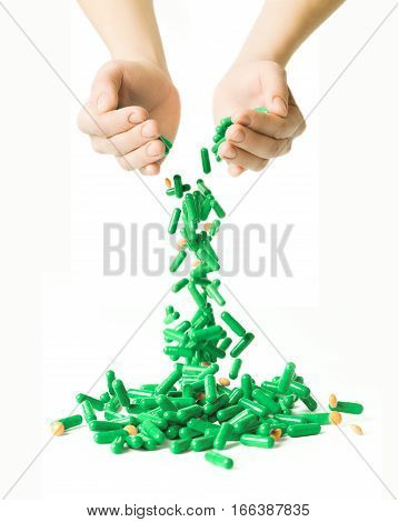Man's Hands Holding And Dropping A Handful Of Medicine Pills