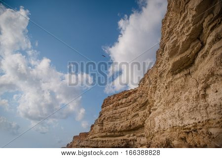 Beautiful mauntain under sky with clouds. White cliffs on the beach of Fecamp, France