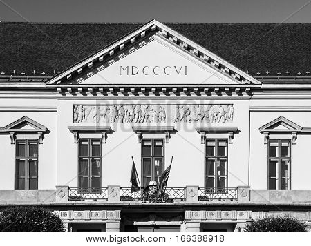 Sandor Palace, aka Alexander Palace, near Buda Castle in Budapest, Hungary, Europe. Detailed view of tympanum with Roman numeral year 1806. Black and white image.