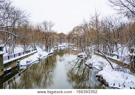 The river Yauza in the North of Moscow in winter during a thaw, the view from the bridge