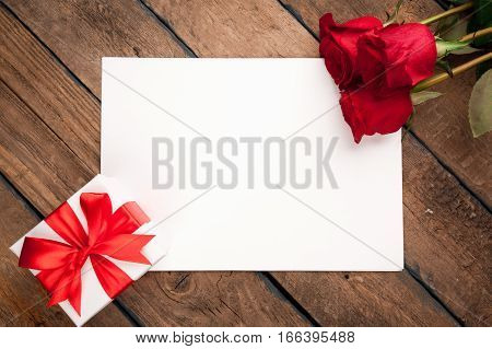 Red roses, gift box and Valentine's day greeting card