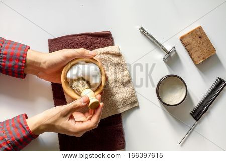 Instruments male hairdresser barbershop top view on white background with hands