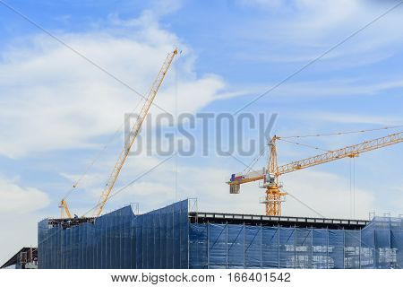under construction building with the crane and the sky.