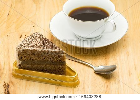 Coffee cake with a cup of coffee on wooden board