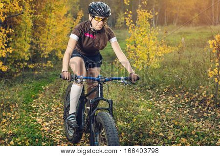 Girl Cyclist In Nature On A Mountain Bike, Concept Sports