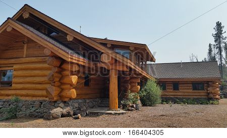 Comfortable log cabin in the woods during the day