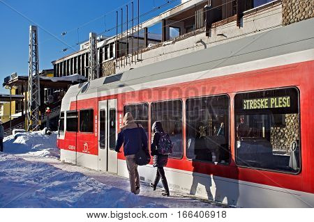SLOVAKIA, STRBSKE PLESO - JANUARY 06, 2015: High speed electric train arrived on the railway station in Strbske Pleso. Is a is a favorite ski tourist and health resort in the High Tatras mountains.