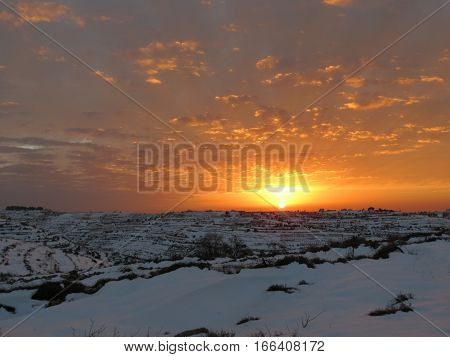 A spectacular sunset on a snowy mountain