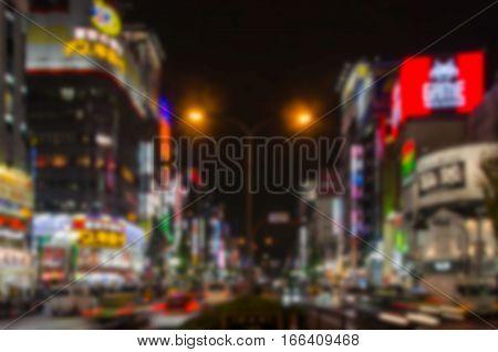 Abstract blur Shinjuku's Kabuki central road in Tokyo Japan.