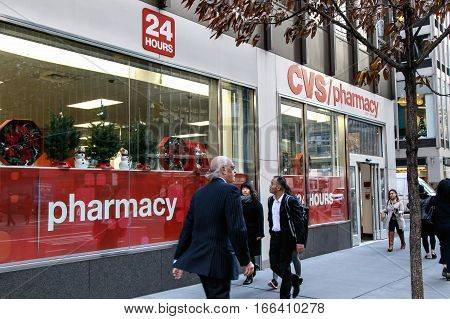 New York December 1 2016: People walk by a CVS pharmacy on 3rd Avenue in Manhattan.