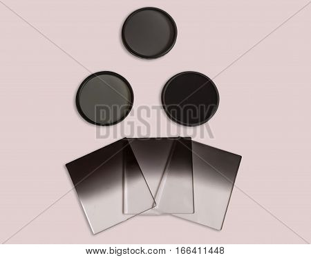 Neutral density and graduated neutral density filters used in camera for photography isolated.