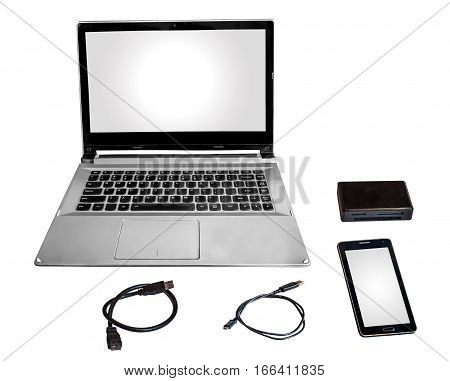 Laptop pc smart phone card reader and data cables chord isolated in white.