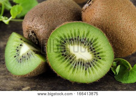 whole and sliced kiwi, healthy food, tropical fruit