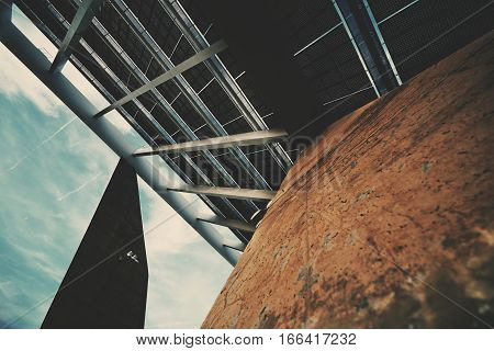 Abstract geometrical fragment of modern hi-tech solar photovoltaic panel huge solar battery giant energy producing structure Barcelona Spain Forum district view from bottom