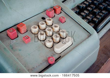 Old antique cash register, adding machines or antique calculate in old convenience store.