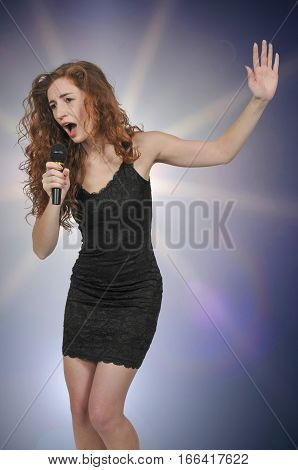 Beautiful woman singer performing at a concert