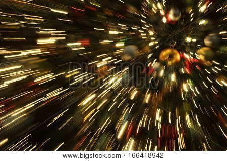 blurred Golden Christmas Tree Holiday Lights  motion blur with zoom effect