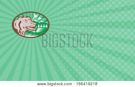 Business card showing Illustration of a labrador golden retriever dog with pheasant goose bird flying mountains trees in background set inside ellipse done in retro woodcut style.