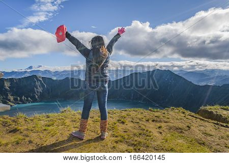 Young Woman With Hands Up Quilotoa Lake