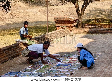 Vendor Selling Buddha Paintings At Temple